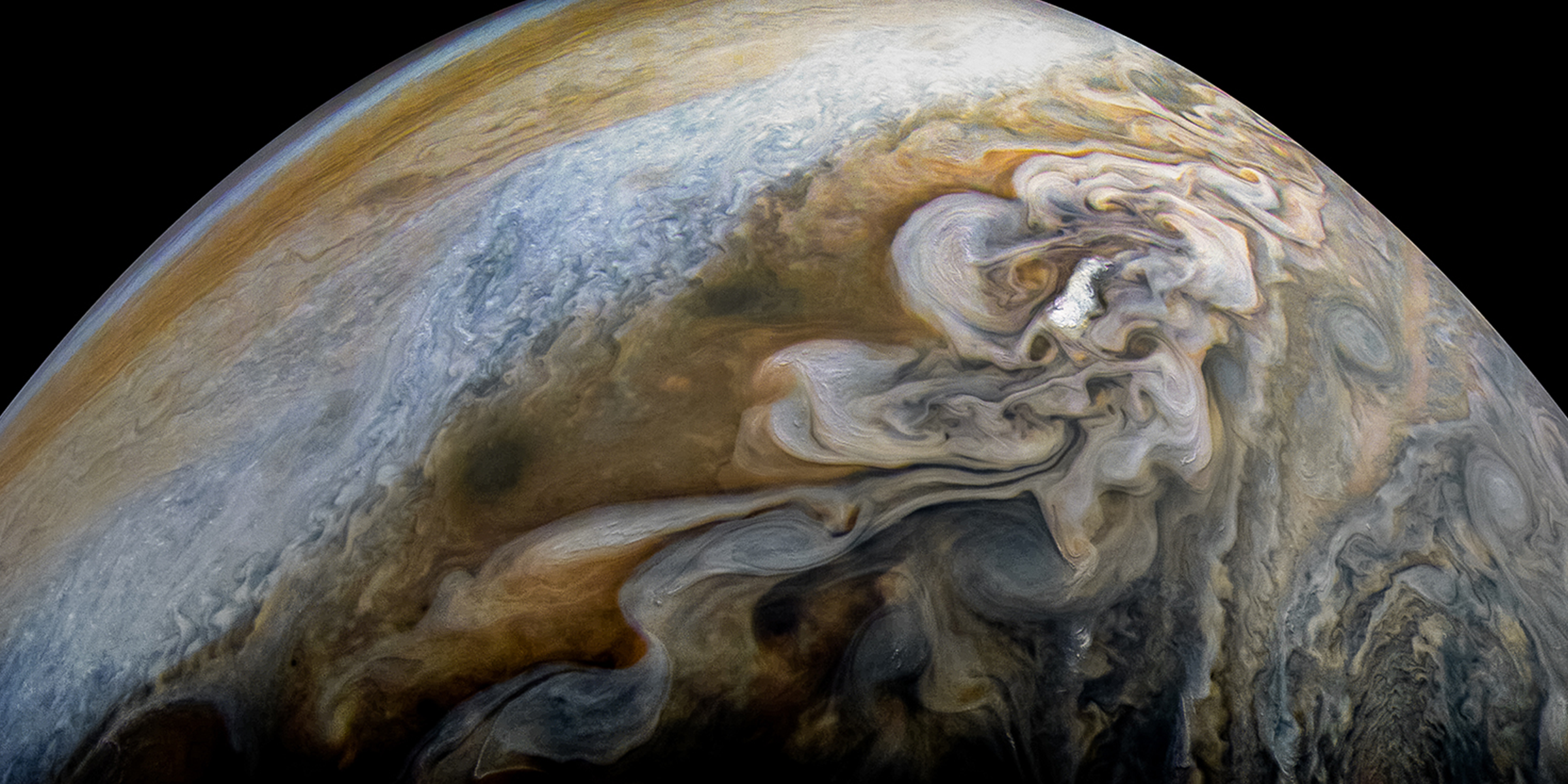 Jupiter's Swirling Cloud Formations. Credit: NASA, JPL-Caltech, SwRI, MSSS, Kevin M. Gill.